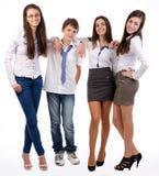 Grupo de sorriso feliz de estar dos amigos Fotos de Stock