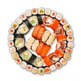 Grupo de sushi, de maki, de gunkan e rolos isolados no branco Fotografia de Stock Royalty Free