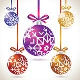 Grupo de suspensão colorido das bolas do Natal na fita para a árvore de Natal Fotos de Stock Royalty Free