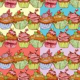 Grupo de testes padrões sem emenda com os queques doces decorados Imagens de Stock