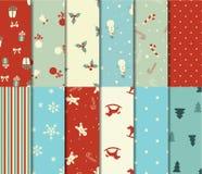 Grupo de 12 testes padrões sem emenda do Natal Fotos de Stock Royalty Free
