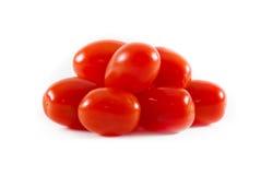 Grupo de tomates de cereza en el fondo blanco Foto de archivo