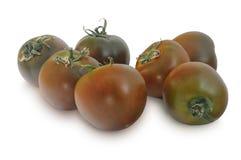 Grupo de tomates de Kumato isolados no fundo branco Imagem de Stock