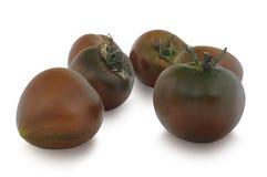 Grupo de tomates de Kumato isolados no fundo branco Fotos de Stock Royalty Free