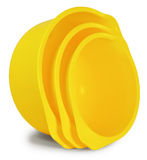 Grupo de três bacias plásticas amarelas Foto de Stock Royalty Free