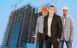 Grupo de três coordenadores e arquitetos Fotografia de Stock Royalty Free