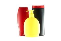 Grupo de três garrafas para produtos de higiene. Foto de Stock Royalty Free
