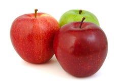 Grupo de três vermelhos e de maçãs verdes Imagem de Stock Royalty Free