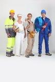 Grupo de trabajadores imagenes de archivo