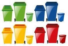 Grupo de trashcans em cores diferentes Foto de Stock Royalty Free