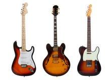 Grupo de tres guitarras eléctricas en blanco Foto de archivo libre de regalías