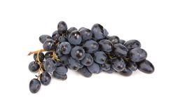 Grupo de uvas pretas maduras e suculentas. Foto de Stock
