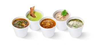 Grupo de várias sopas do restaurante, isolado no branco Fotos de Stock Royalty Free