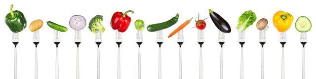 Grupo de vegetais saborosos em forquilhas Fotos de Stock Royalty Free