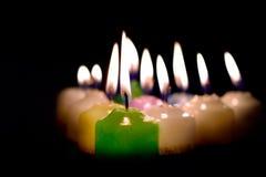 Grupo de velas ardientes Imagenes de archivo
