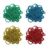 Grupo de verde, azul, vermelho, festão festiva do amarelo isolada no fundo branco Imagens de Stock