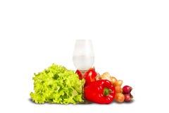 Grupo de verduras con el vidrio de agua Imágenes de archivo libres de regalías