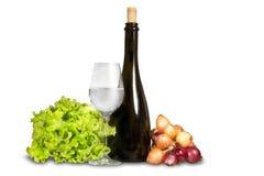 Grupo de verduras con el vidrio y la botella de agua Foto de archivo