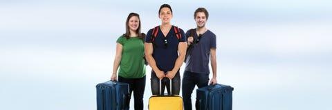Grupo de viagem do curso de férias da bandeira do copyspace dos jovens fotografia de stock