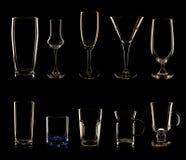 Grupo de vidros e de garrafas múltiplos Fotos de Stock Royalty Free