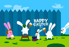 Grupo del conejo que se coloca en bandera feliz del día de fiesta de la pared de Pascua de la pintura del cepillo del control de  Imagenes de archivo