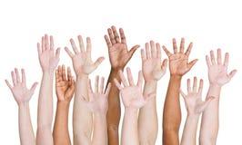 Grupo diverso de manos aumentadas para arriba Imágenes de archivo libres de regalías