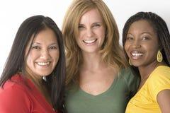 Grupo diverso de mujeres aisladas en blanco Imagen de archivo libre de regalías