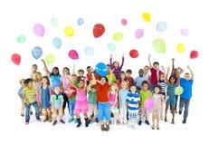 Grupo diverso de niños que celebran Fotografía de archivo libre de regalías