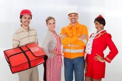 Grupo diverso de trabajadores sonrientes imágenes de archivo libres de regalías