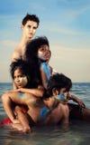 Grupo diverso en la playa Imagen de archivo