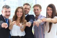 Grupo diverso feliz que señala en usted Fotos de archivo libres de regalías