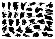 Grupo do curso da escova do preto do vetor da pena da tinta do Grunge fotos de stock royalty free
