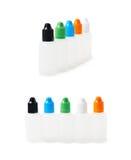 Grupo do plástico garrafas de 30 ml Fotografia de Stock Royalty Free