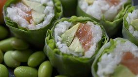 Grupo do rolo do sushi e de sushi filme