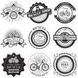 Grupo do vetor de etiquetas da oficina de reparações da bicicleta e de elementos do projeto no estilo preto e branco do vintage L Foto de Stock