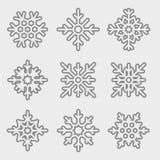 Grupo do vetor de flocos de neve lineares Linha fina flocos de neve Imagens de Stock