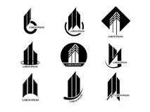 Grupo do vetor de logotipo abstrato da torre da construção dos bens imobiliários no fundo branco Fotografia de Stock
