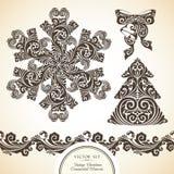 Grupo do vetor de símbolos decorativos decorativos do vintage do Natal Imagem de Stock Royalty Free