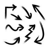 Grupo do vetor de setas pretas isoladas, desenhos do Grunge do risco fotografia de stock