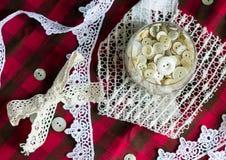 Grupo dos botões brancos em um vidro Fotos de Stock Royalty Free