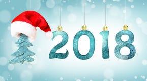 Grupo dos dígitos brilhantes de prata no fundo do brilho Fundo 2018 do ano novo Natal foto de stock
