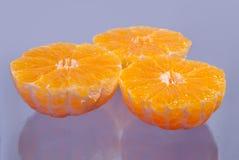 Grupo dos mandarino no lilac Imagens de Stock