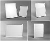 Grupo dos quadros brancos para pinturas ou fotografias no backgro cinzento Foto de Stock Royalty Free