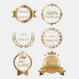 Grupo dourado da coleção do metal do projeto do certificado da etiqueta da qualidade do vetor do selo da medalha de ouro do crach Fotografia de Stock Royalty Free