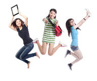 Grupo emocionado de salto de las estudiantes Fotografía de archivo libre de regalías