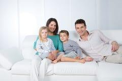 Grupo feliz da família no fundo branco Fotos de Stock
