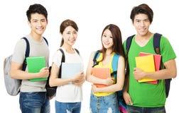 Grupo feliz das estudantes universitário no branco Fotos de Stock