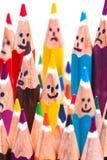 Grupo feliz de caras do lápis como a rede social Imagens de Stock