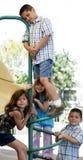 Grupo feliz de jugar de los niños Fotos de archivo libres de regalías