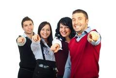 Grupo feliz dos povos que aponta a você foto de stock royalty free